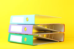 Office folders. Colorful office folders on yellow background Royalty Free Stock Photo