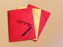 Office folders on desk. Colorful office folders on desk Royalty Free Stock Photos
