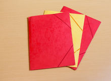 Office folders on desk. Red and yellow office folders on desk Stock Photos