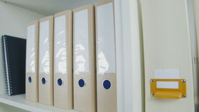Office folders on a shelf stock footage