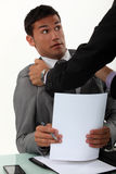 Office fracas. Between two colleagues royalty free stock photography