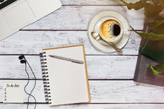 Office or freelancer workspace with to do list and laptop. Freelance blogger, journalist or writer workspace concept. Laptop, books, sketchbook with pen Royalty Free Stock Photography