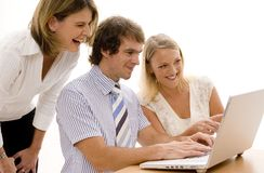 Office Fun. Three colleagues share a joke at the computer Royalty Free Stock Photography