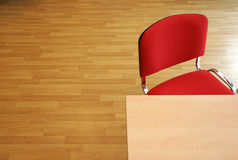 Office furniture. Office with furniture, wooden table, red chairs and ground of platform Royalty Free Stock Photography