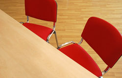 Office furniture. Office with furniture, wooden table, red chairs and ground of platform Stock Photography