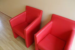 Office furniture. Office with furniture, wooden table, red chairs and ground of platform Royalty Free Stock Photos