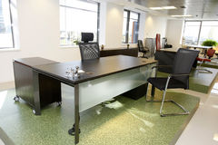 Office furniture. Business office with desk and chairs in a corporate building royalty free stock photo