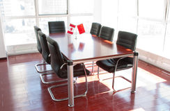 Office furniture in conference room. Canadian flag and Chinese flag royalty free stock images