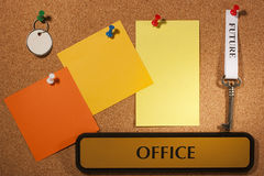 Office Future. Key with a future tag hanging on a brown board. Add your text to the background Royalty Free Stock Images