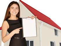Office girl on background of house holding clip Royalty Free Stock Images