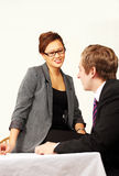 Office girl chats with co-worker Royalty Free Stock Images