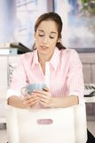 Office girl on coffee break Stock Photography