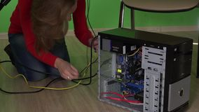Office girl connect cables to computer under table. Woman repairing pc. Office girl connect cables to computer under table. Woman repairing desktop pc. Static stock video footage