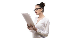 Office girl in glasses holds papers in hands isolated on white Stock Image