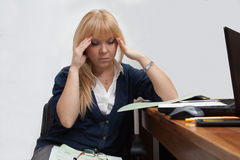 Office girl having a headache Royalty Free Stock Photography