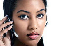 Office girl on headset Royalty Free Stock Photo