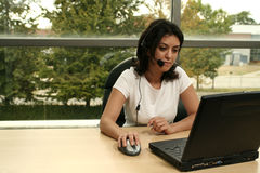 Office girl with headset. In white royalty free stock photos