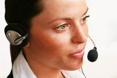 Office girl on headset Stock Image