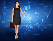 Office girl holding a briefcase standing on Stock Image