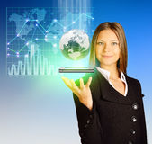 Office girl holding a globe and phone in hand. Royalty Free Stock Photo