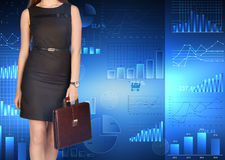 Office girl holding leather briefcase on Stock Photo