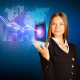Office girl holding a tablet with charts and Royalty Free Stock Images