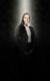 Office Girl Illuminated with Light Above on Black Stock Images