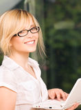 Office girl with laptop computer Royalty Free Stock Image