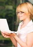 Office girl with laptop computer Stock Image