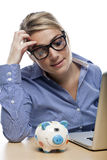 Office Girl with Laptop and Piggy Bank at Table Stock Photography