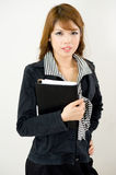 Office girl with notebook. An office girl or secretary posing with a notebook for apointments and notes Royalty Free Stock Photos