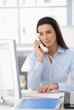 Office Girl On Landline Call Royalty Free Stock Photos