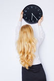 Office Girl Sets the Clock Stock Image