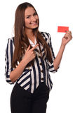Office girl showing card isolated on a white background Stock Images