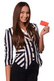 Office girl showing card  on a white background Royalty Free Stock Photo