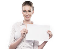 Office girl in white blouse holds papers in hands and smiles isolated on white Royalty Free Stock Images