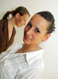 Office girls posing. Two office women posing Stock Photo
