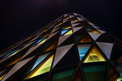Office glass building in abstract at night. Office glass building at night Stock Photography
