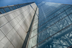 Office glass building in abstract. Office skyscraper towards a blue sky. Glass building in abstract stock image