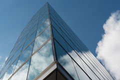 Office glass building in abstract. Office skyscraper towards a blue sky Royalty Free Stock Images