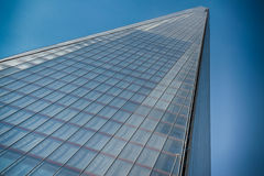 Office glass building in abstract. Office skyscraper towards a blue sky Stock Image