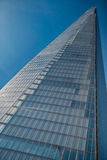 Office glass building in abstract. Office skyscraper towards a blue sky Stock Photography
