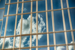 Office glass building in abstract. Office skyscraper towards a clouded sky. Glass building in abstract stock photos