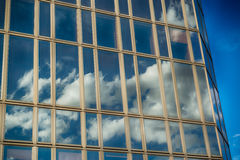 Office glass building in abstract. Office skyscraper towards a clouded sky. Glass building in abstract royalty free stock images