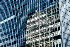 Office glass building in abstract. Office skyscraper with reflections. Glass building in abstract royalty free stock images