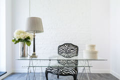 Office with glass desk and zebra armchair Royalty Free Stock Photos