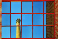 Office glass reflex old factory chimney Royalty Free Stock Photography