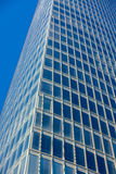Office glass skyscraper building. Vertical filtered shot Royalty Free Stock Photography