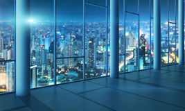 Office with glass wall and evening city Stock Photos