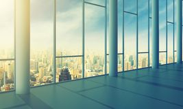 Office with glass wall and sunny weather Stock Images